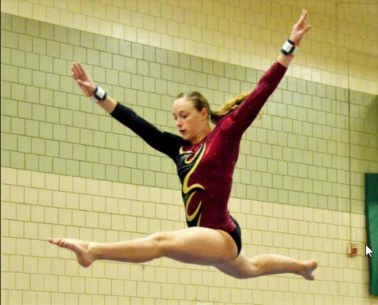 Ellie Stodden leaps above the high beam.