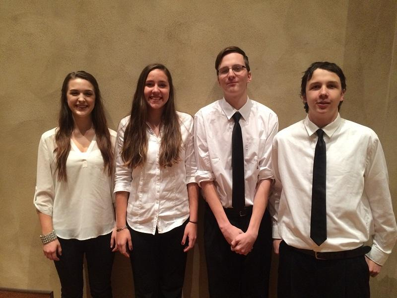 CFHS singers  Anna Schroder, Aria Tennessen, Sam White and Nolan Hartl pose at the Dorian Festival