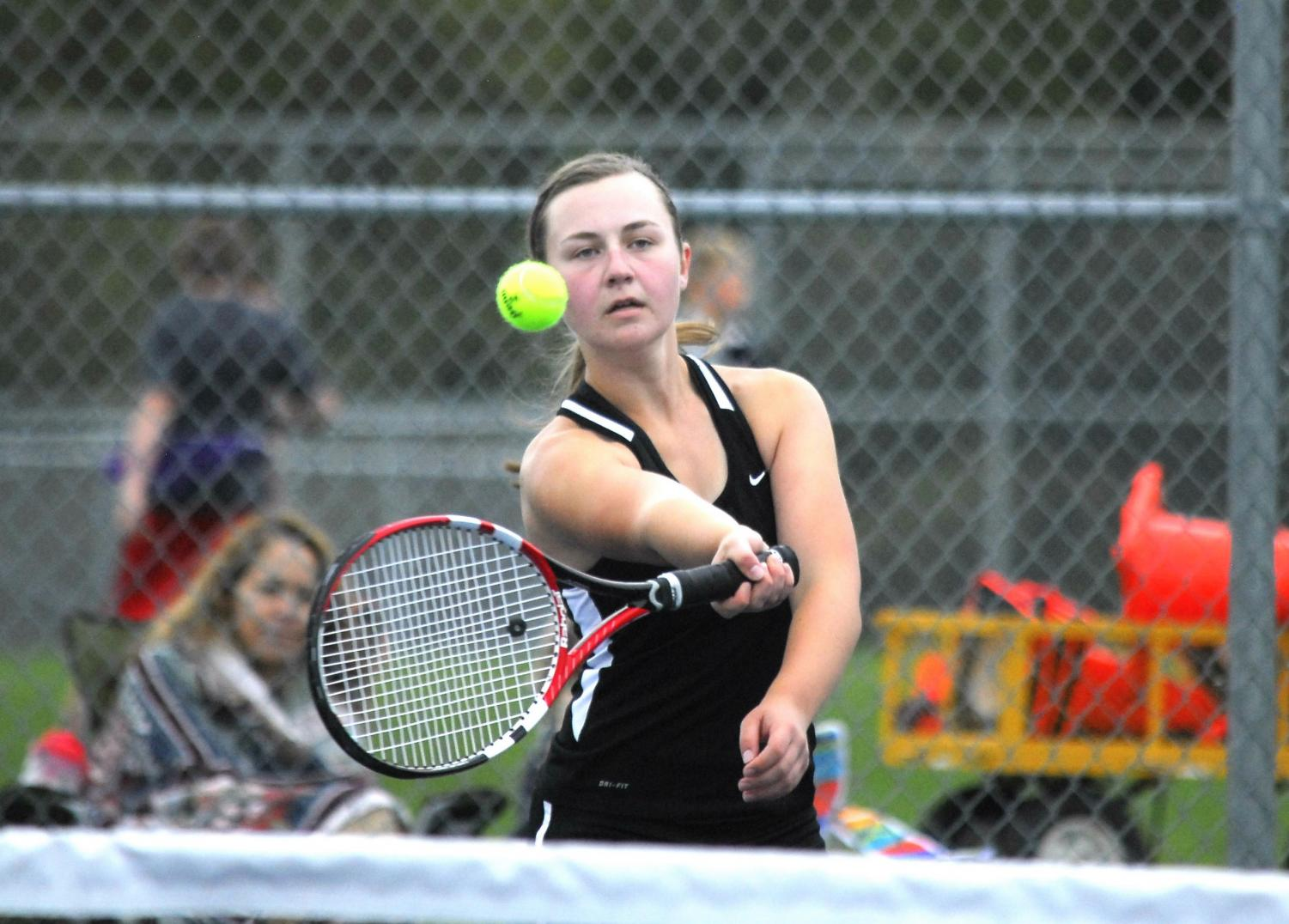 Taylor Jackson goes in to hit a forehand on the tennis team's home courts.