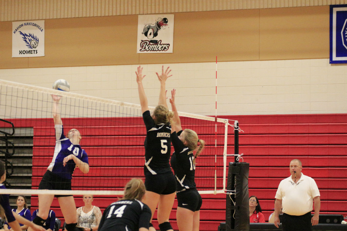 Juniors Olivia Thomley and Morgan Roeber blocking a hit during their playoff game against the Rochester Lourdes.