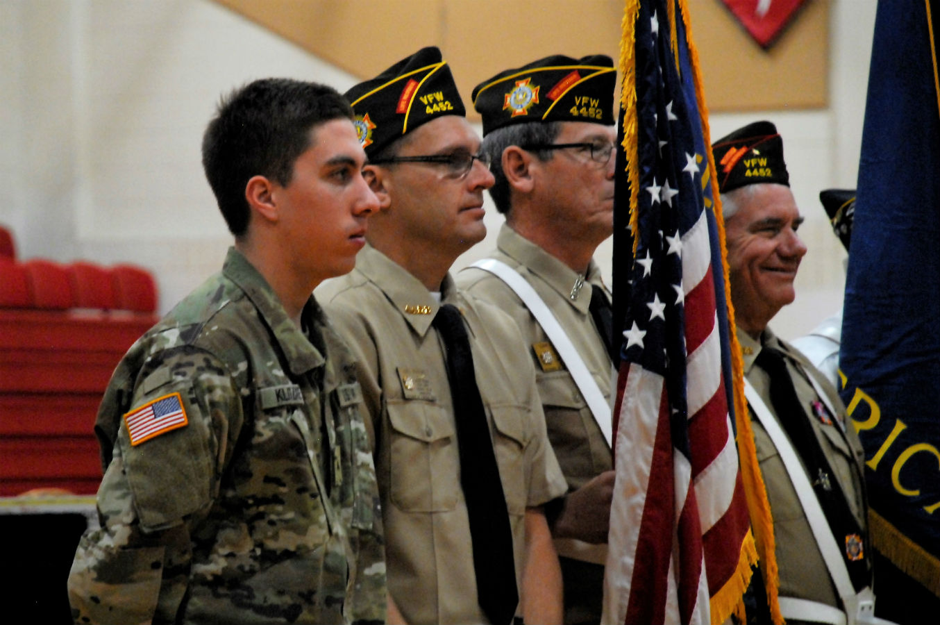 Soldiers, old and new, stand together on Veteran's Day.