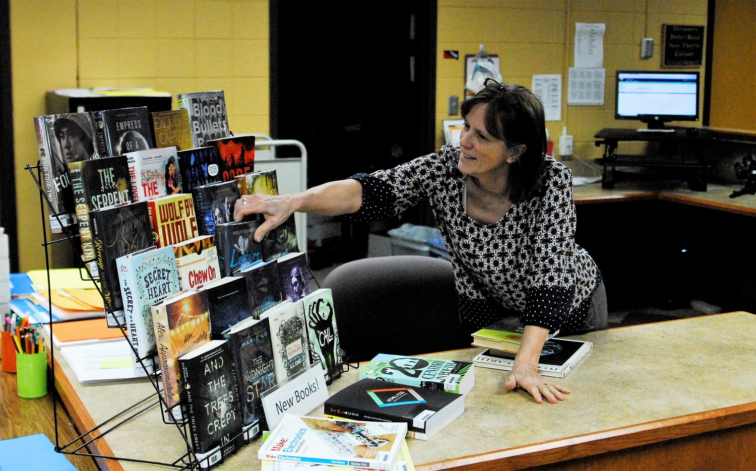 Cindy Derosier maintains a much used library