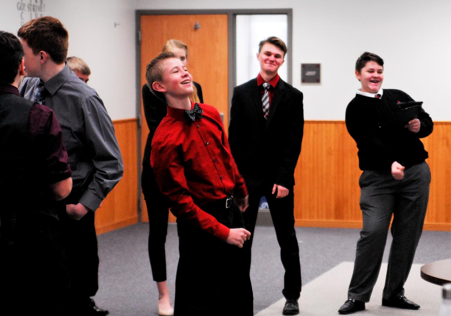 Sophomore, Ryan Schlichting, participates in warm ups with the team before a speech tournament.