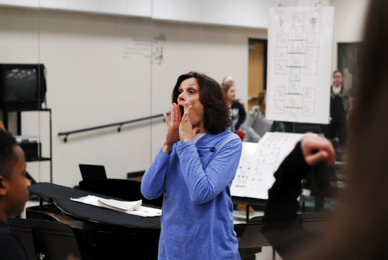 High school teacher of the year,  Mrs. Franke, directing the choir in rehearsal.