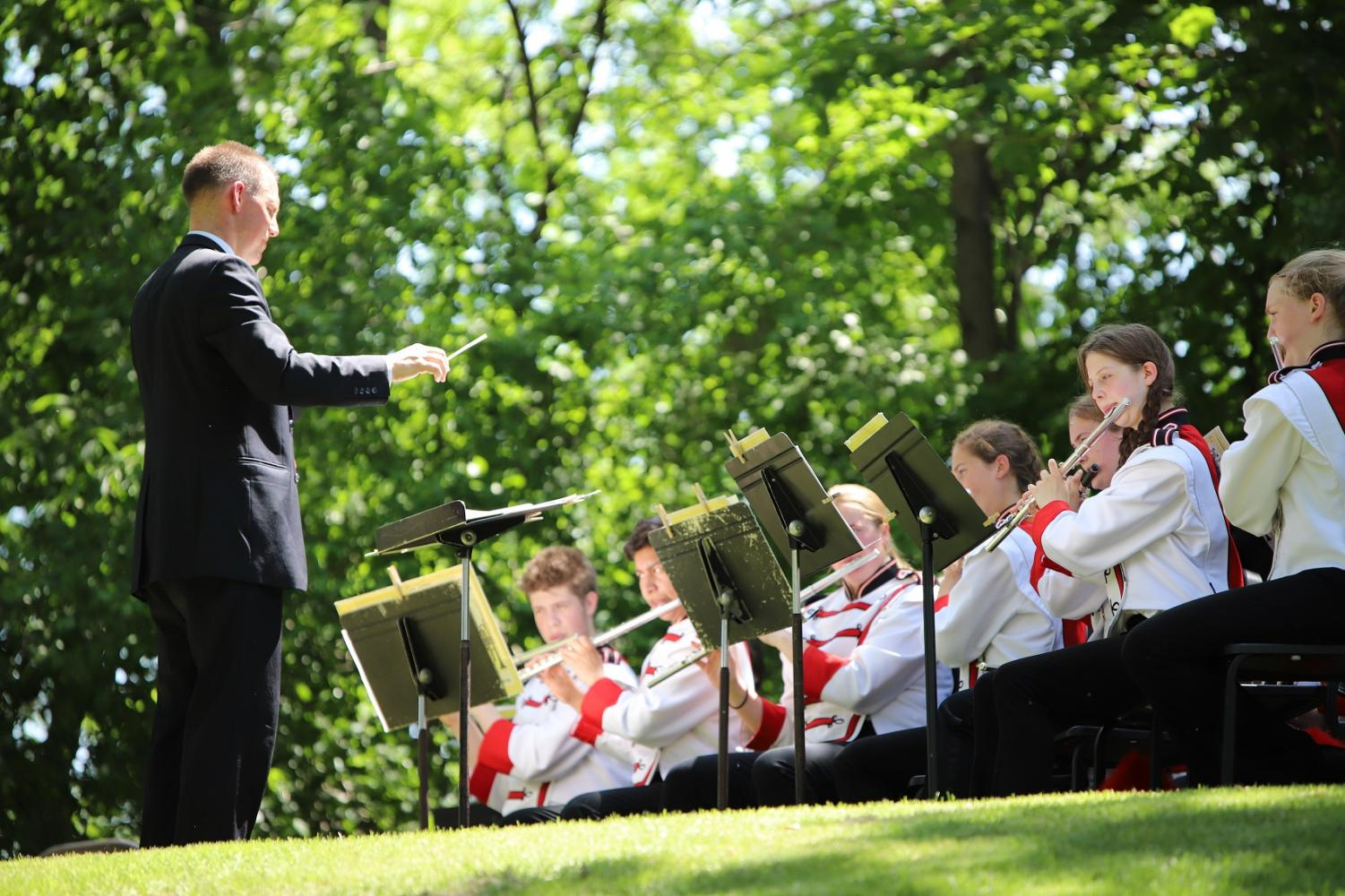 Mike Legvold leads the CFHS band during Memorial Day ceremonies