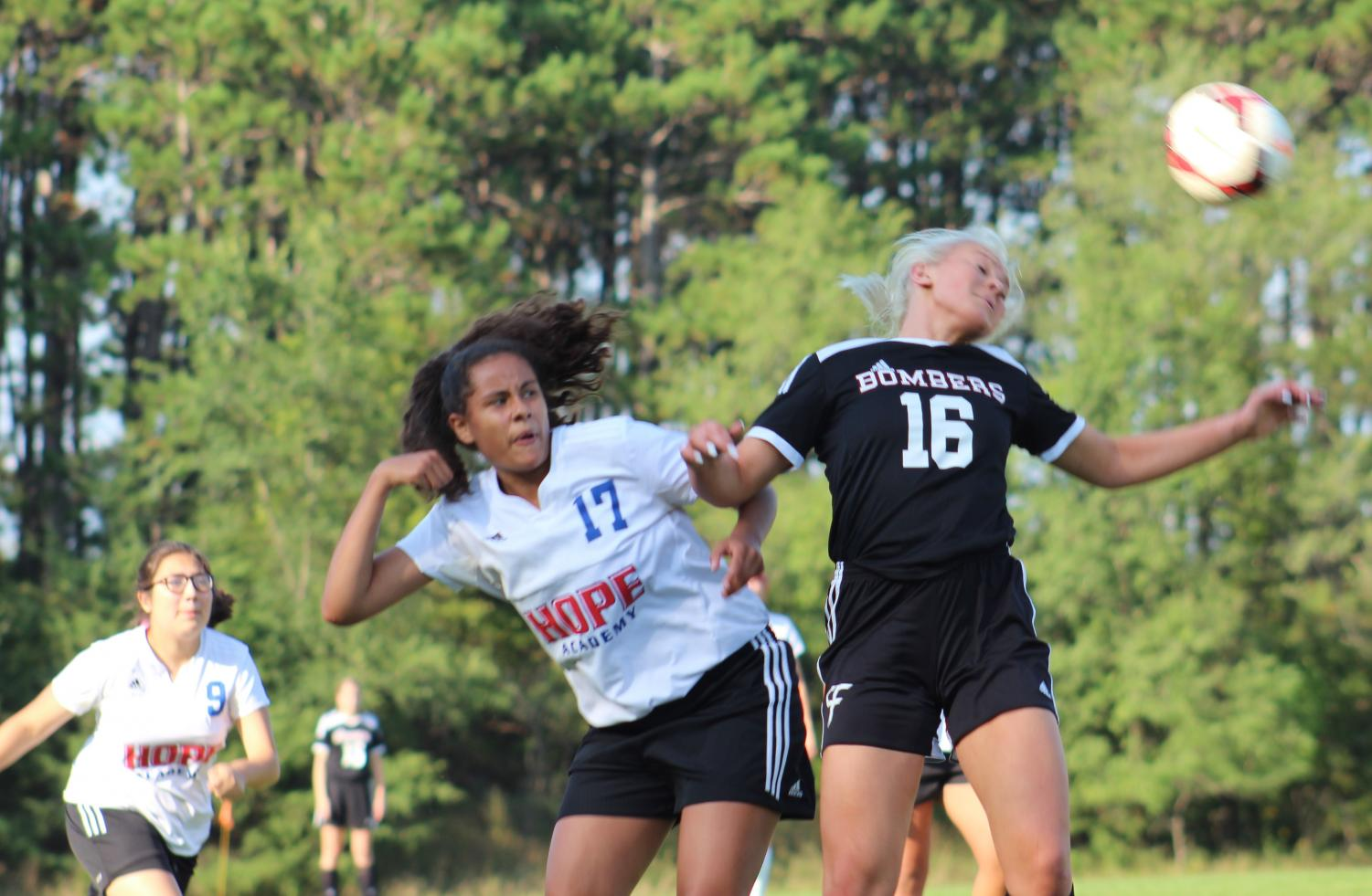 Kelsie Wilcox-Laurel controls the header for her team