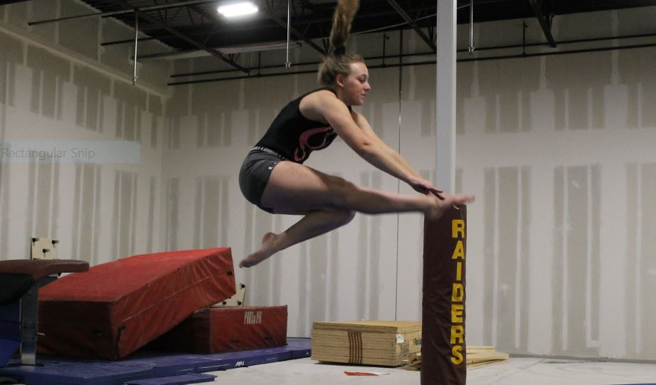 Saundra Stodden prepares for her upcoming gymnastics meet.