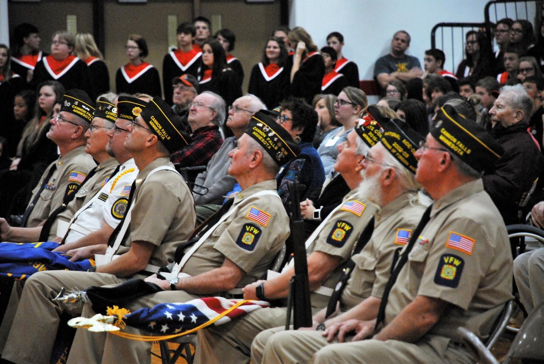 Veterans listen to speaker Jesse Johnson during the Veterans' Day presentation