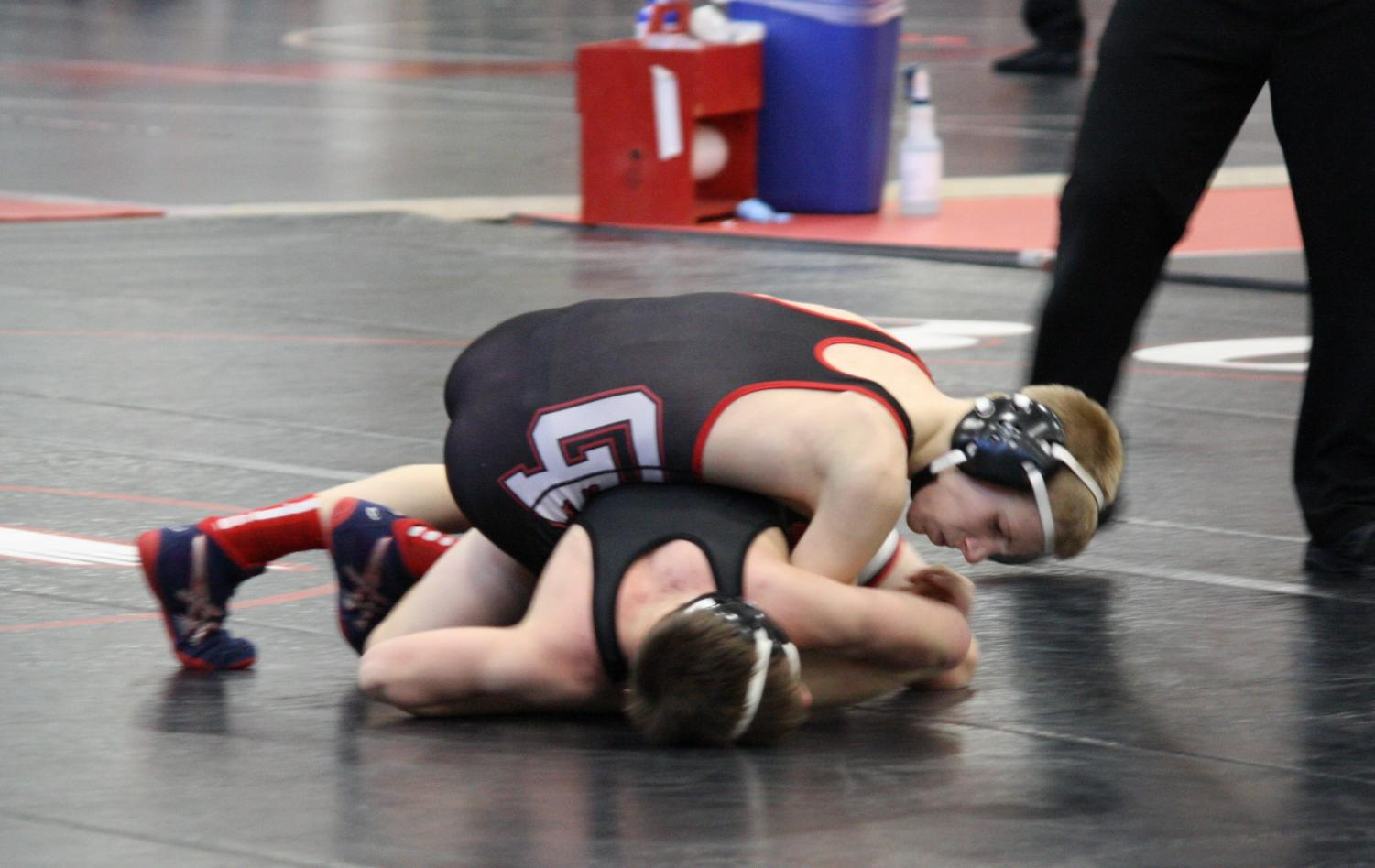 Cannon Falls pins opponent.