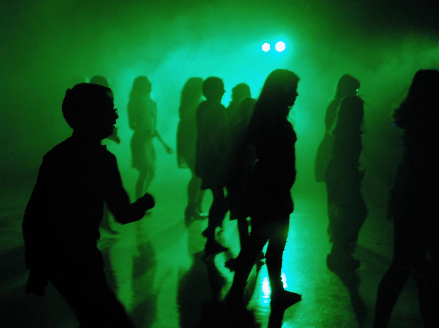 The middle school dance had many cool lights and fog that spread around the dance floor
