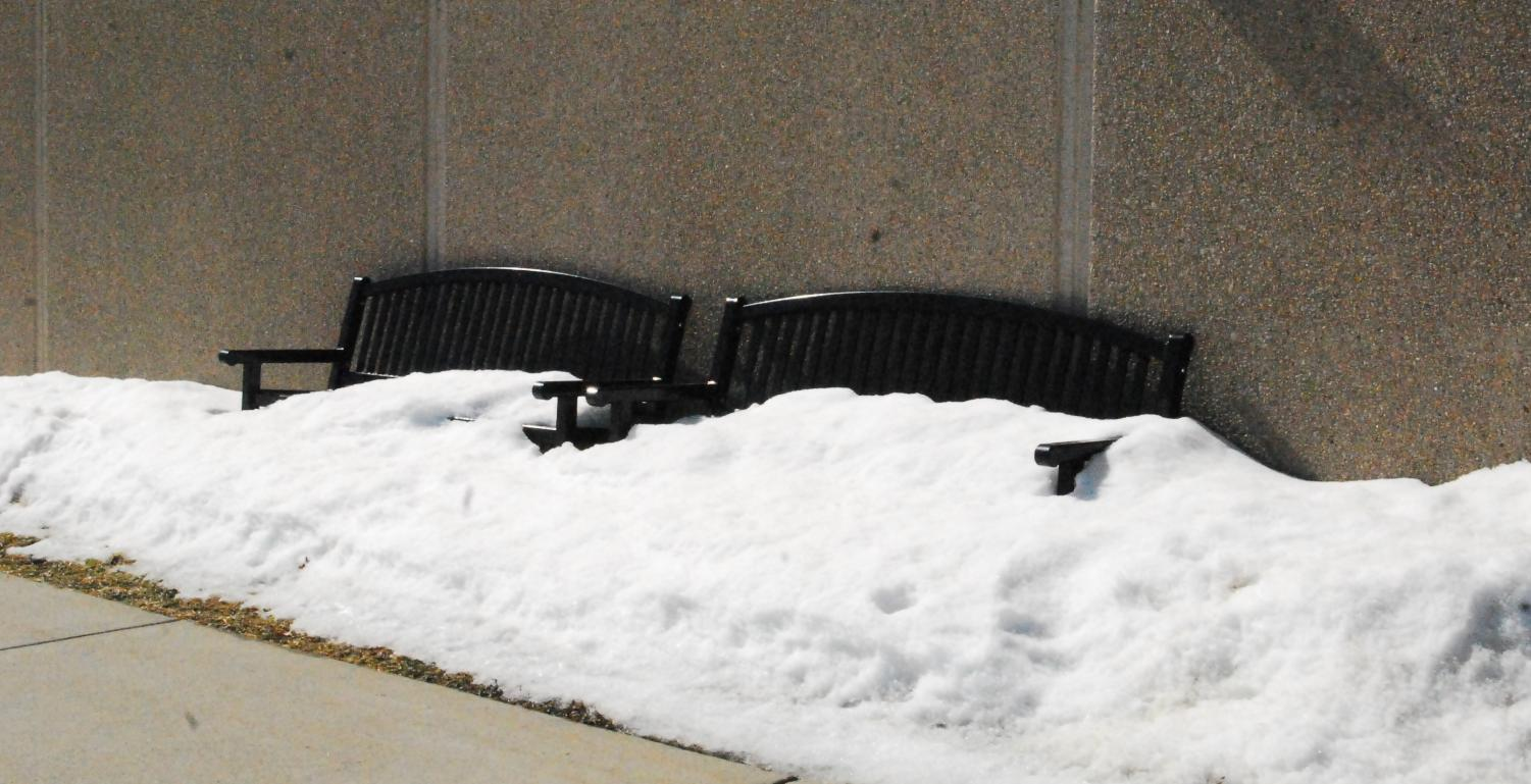 Snow covers the bench outside of the Cannon Falls High School.