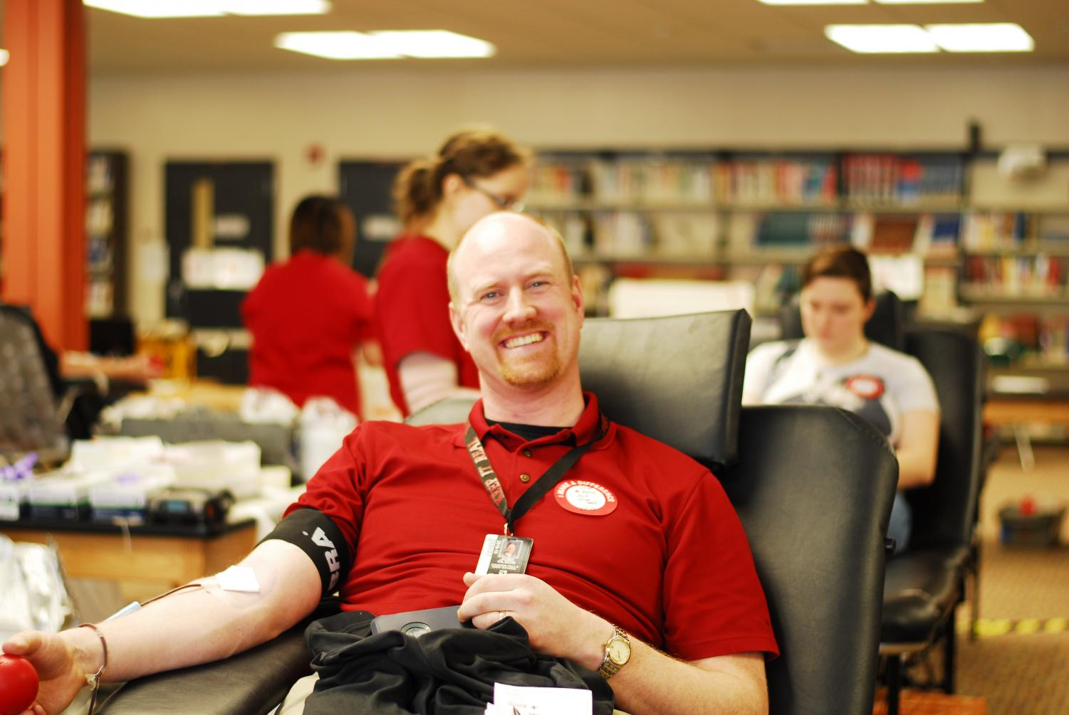 Mr. Olson, a usual donator, is excited to give again at Interact's blood drive.