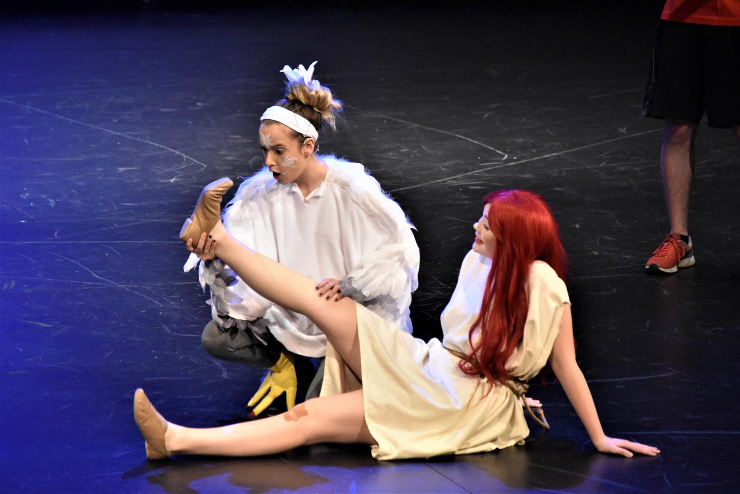 Scuttle (junior Kressin Hartl) gazes in awe at Ariel's (Kendall Lawless') new feet.