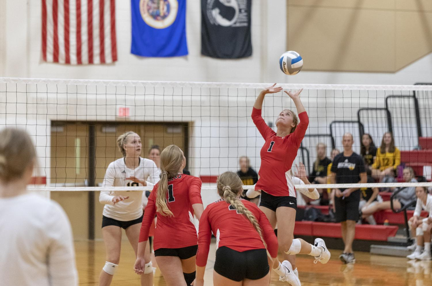Jaci WInchell sets the ball up to Sara Twedt.