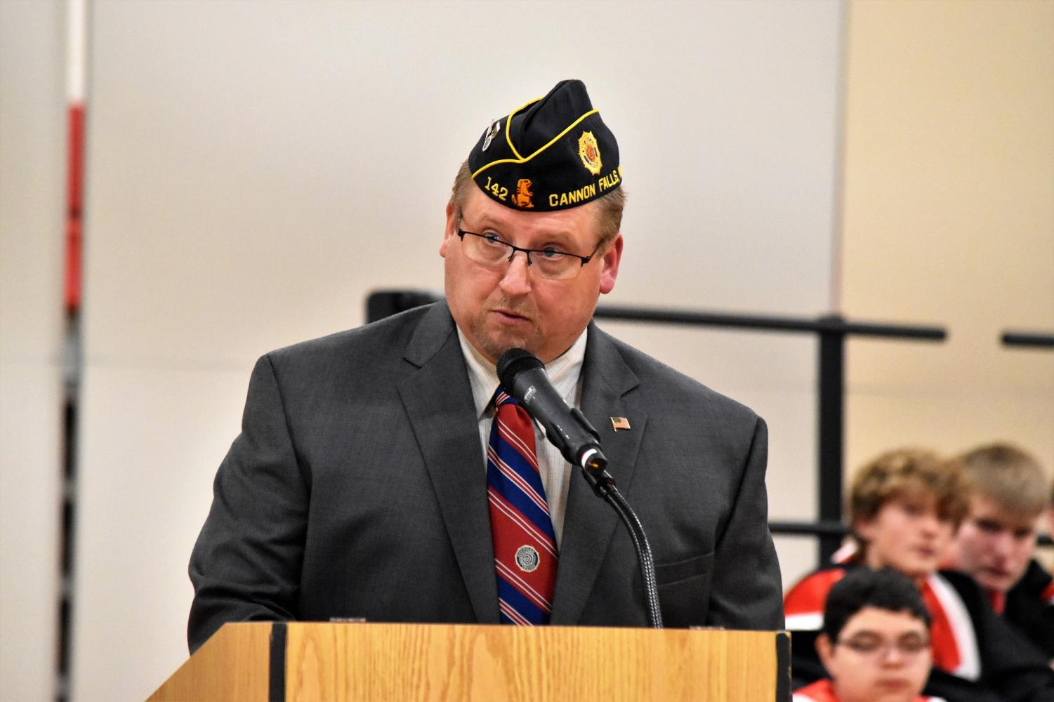 Craig Hedstrom addressed the gym packed full of students on Veterans Day.