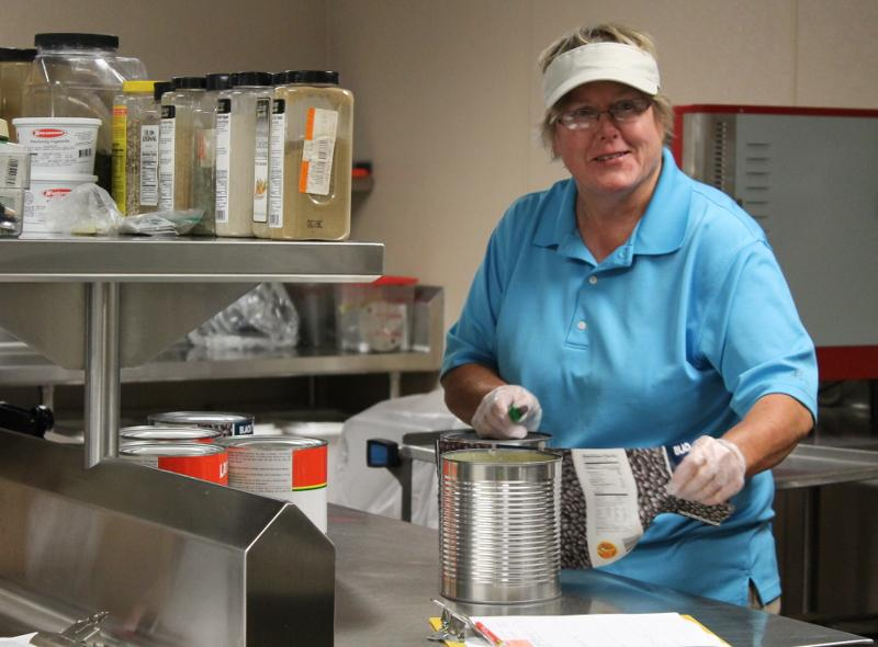 Head cook, Wendy Robinson, gets ready for the lunch hour.  Source: Kallie Nordin