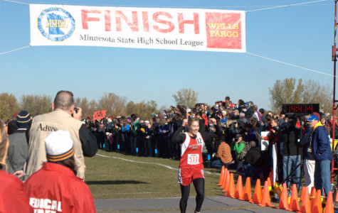 Emi Trost winning the state championship in cross country