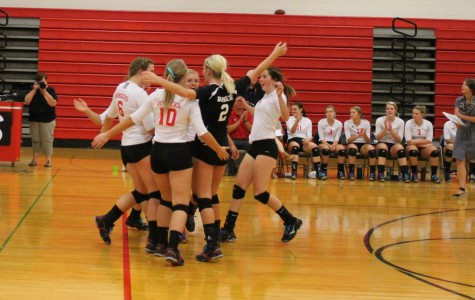 Bomber Volleyball team celebrates another victory at home