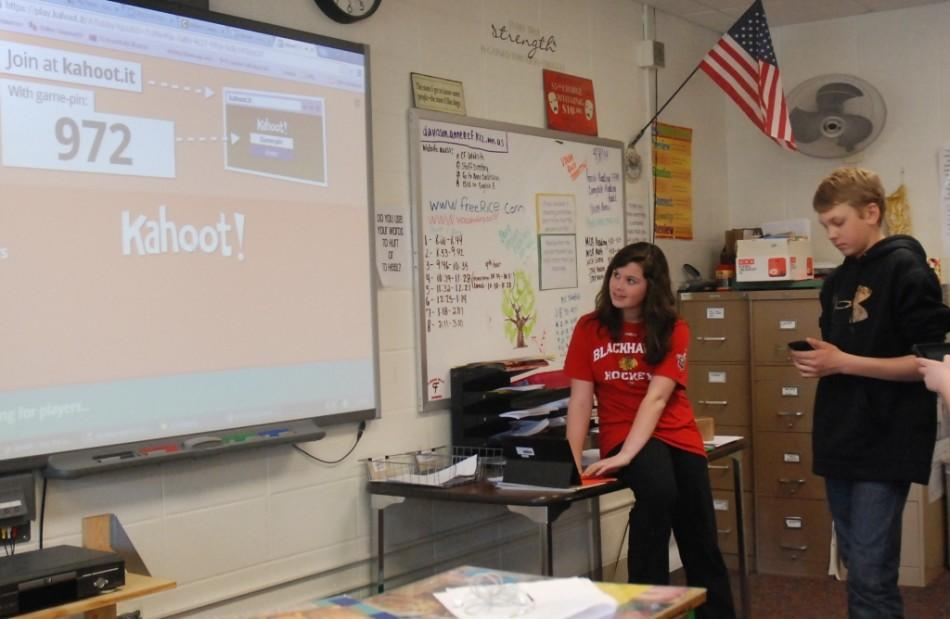 8th grade English students Grace Foster and John Tweidt work with Kahoot program