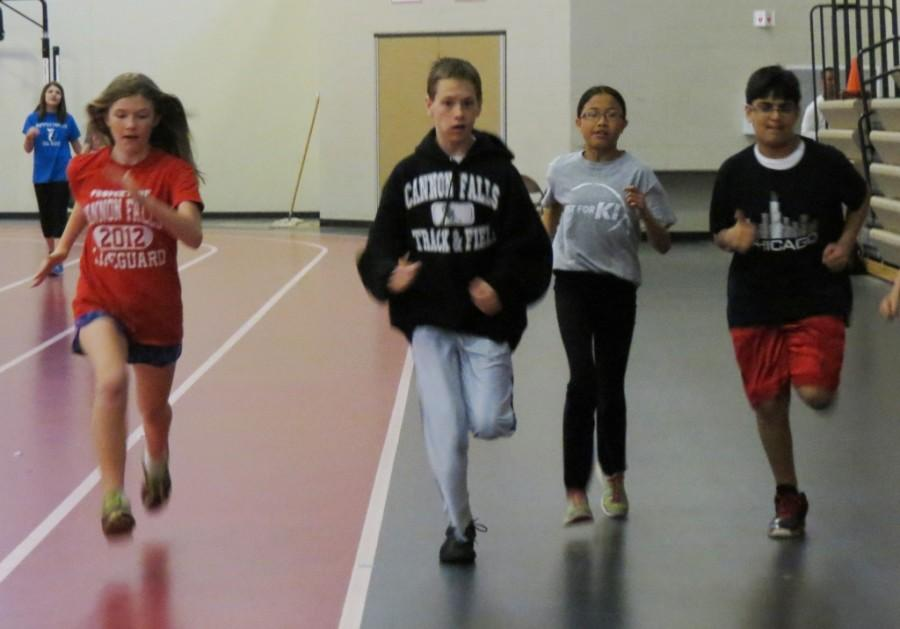 6th grade students get off the line quickly on the junior high track team