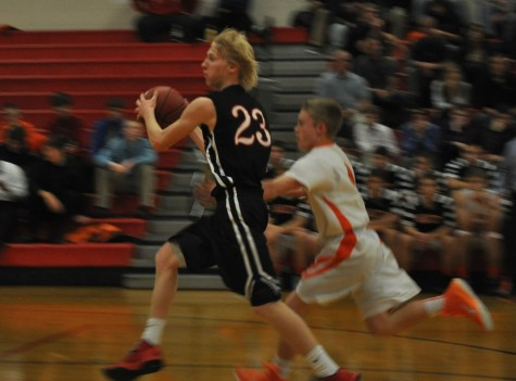 Tanner Carlson drives to the basket in a game against Lake City