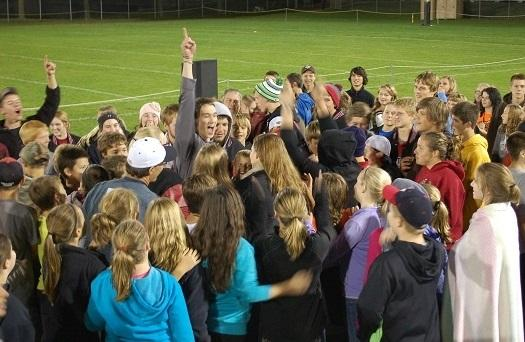 A crowd of students celebrates at a Fields of Faith gathering
