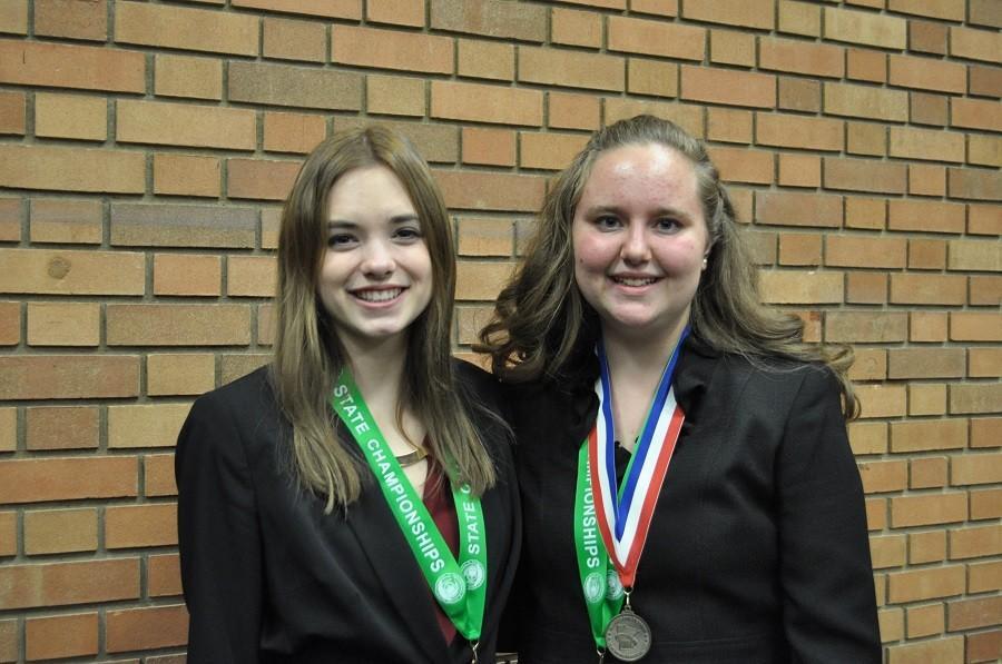 Emma Thomley and Miranda Felton sport their state quarterfinalist ribbons