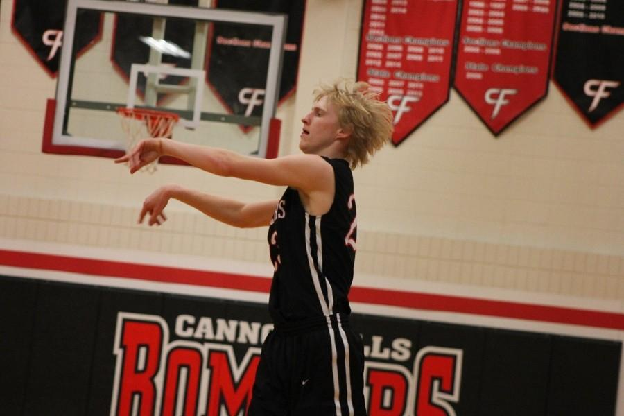 Tanner Carlson passes the ball in a playoff game