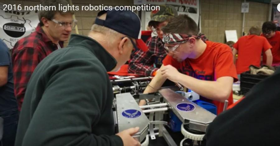 robotics team works in the pit area