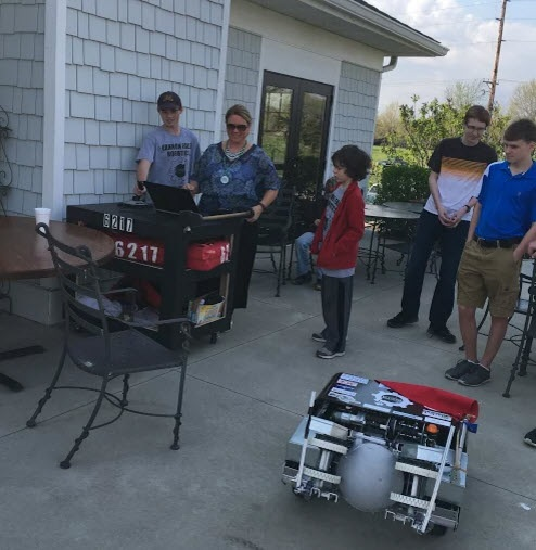 Attendees test out the robot at the Ed. FOundatin auction