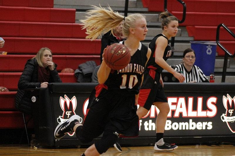 Kaly Banks dashes across the court in a rush to score points.