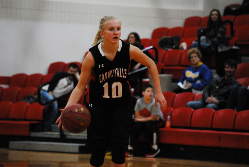 Kaly+Banks+dribbles+the+basketball+as+she+looks+for+an+opening+in+the+opponents+defense.
