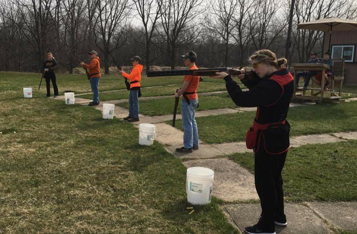 Students prepare for the state trap shooting tournament