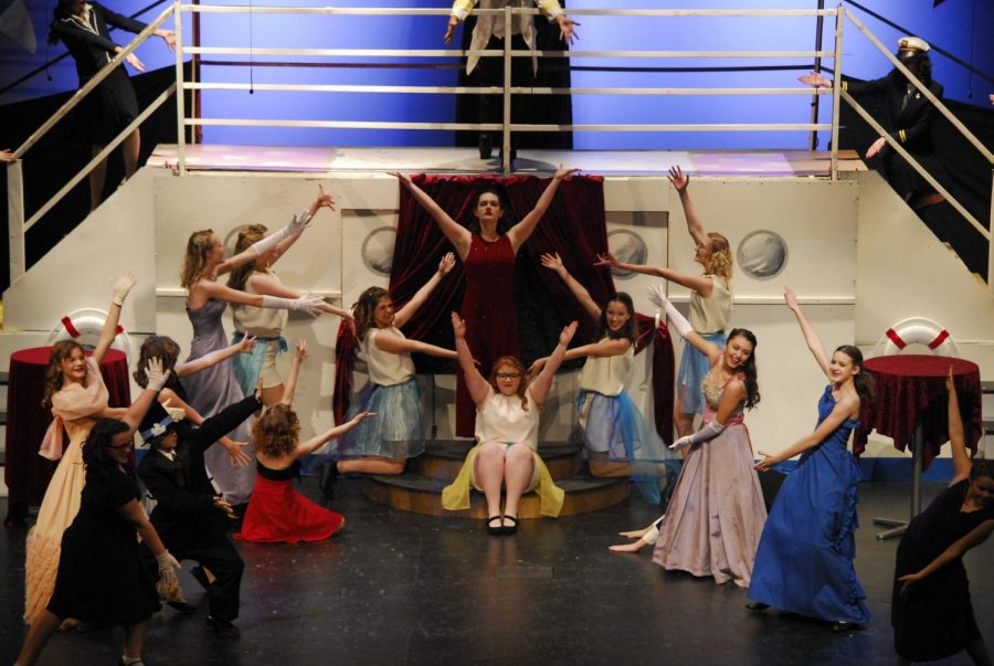 All of the ensemble surround senior Carley Norton at the end of