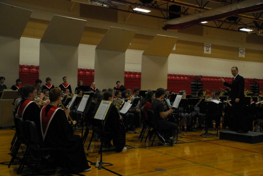 The concert band plays at the Veterans Day program for the high school.