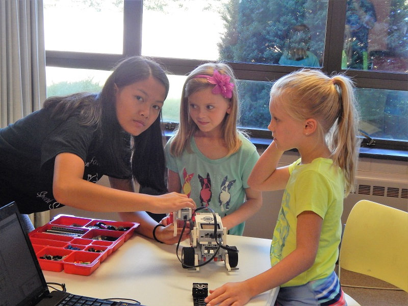Zoe Jesh works with girls in the elementary school and teaches them about robotics.