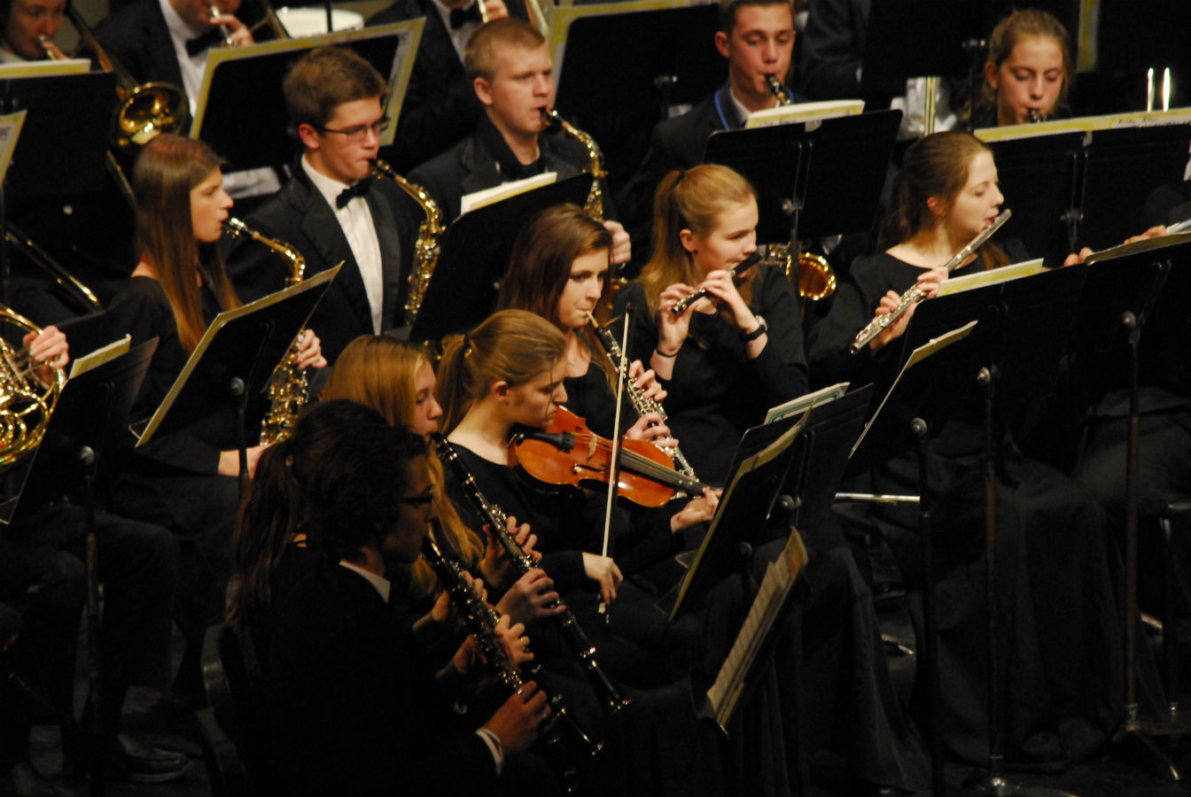 The concert band plays at their annual holiday concert in the auditorium.