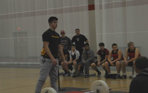 Broderick Ulrich prepares to begin his lift