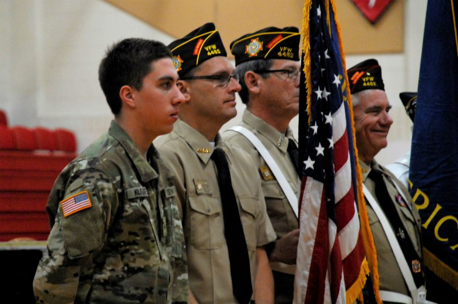 Soldiers, old and new, stand together on Veterans Day.