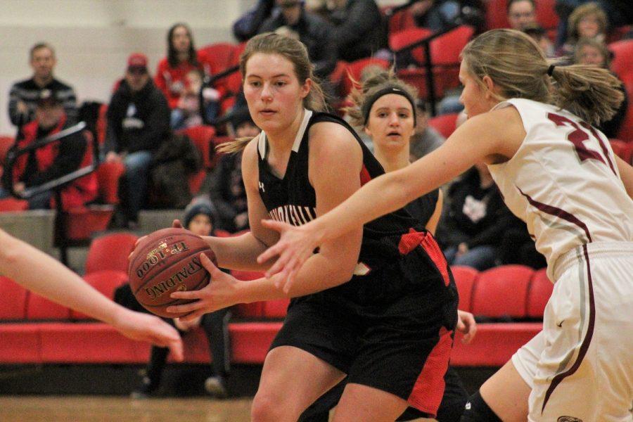 Senior Kira Jacobson passing to a teammate.