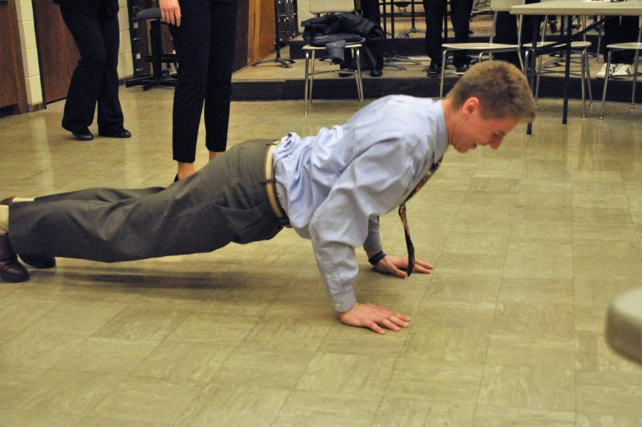 Schlichting does push ups to warm up for a speech tournament.
