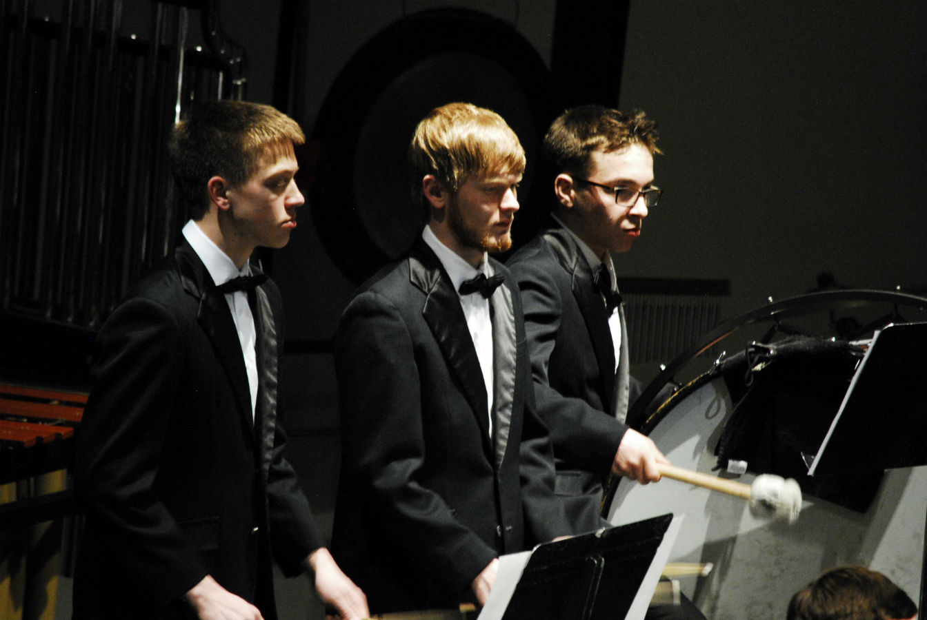 Percussionists focus on their piece during the March band concert.