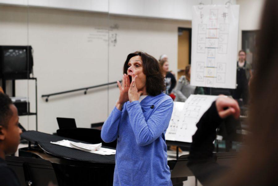 High school teacher of the year,  Mrs. Franke, directing the choir in rehearsal.