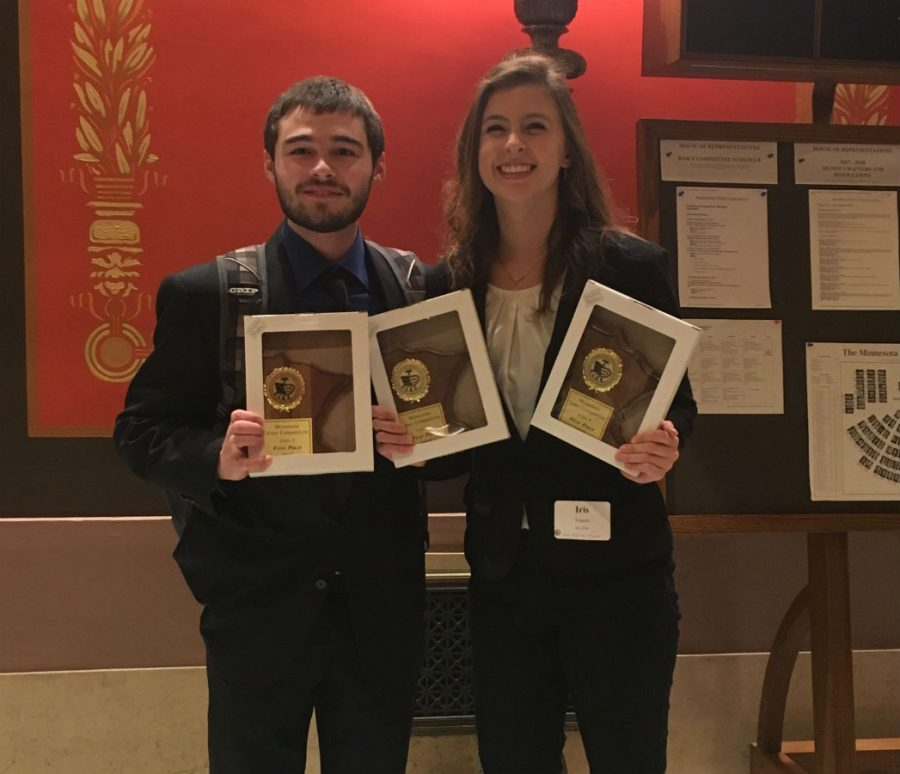 Garett Klavon and Iris French with their We the People state champion awards.