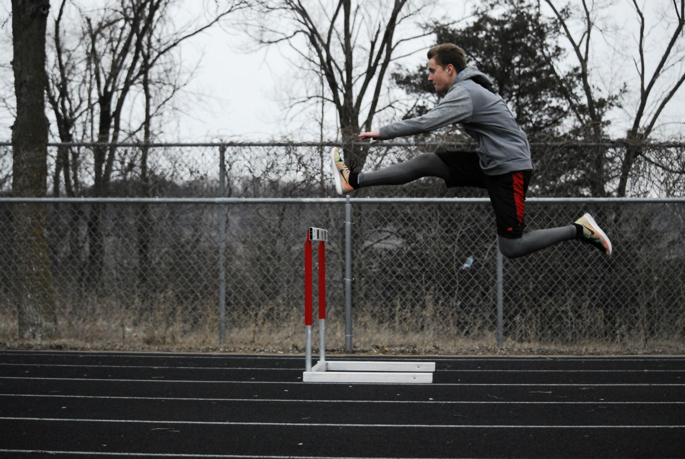 Bryson Felton practicing hurdles outside once the snow has finally melted.