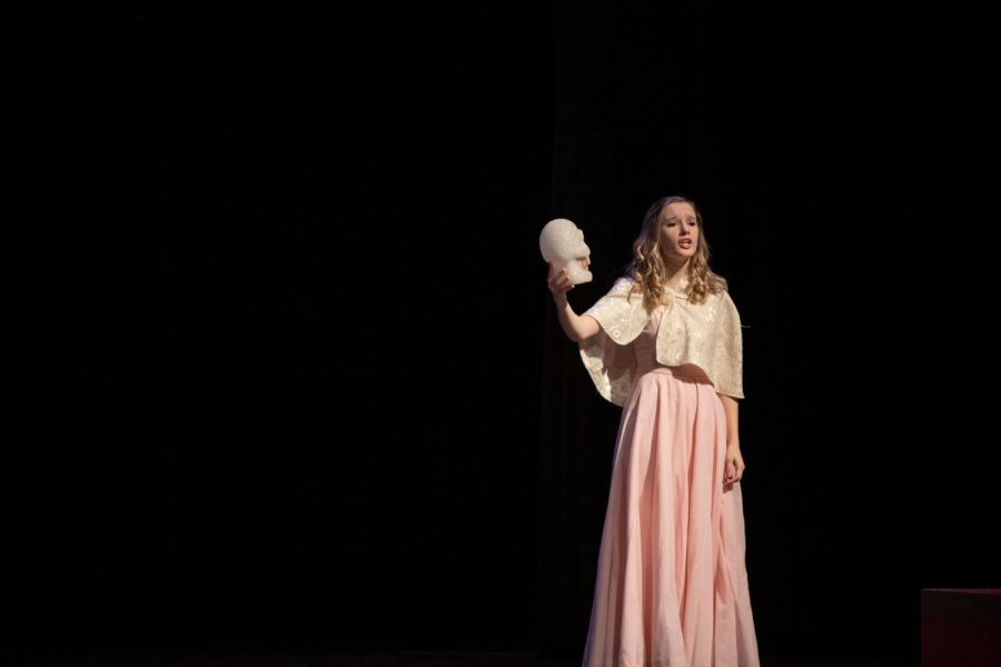 Kressin Hartl is forlorn on stage as she holds the skull of poor Yorick