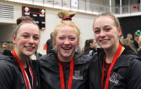 Ellie, Laurie, and Saundra are smiling after a successful competition.