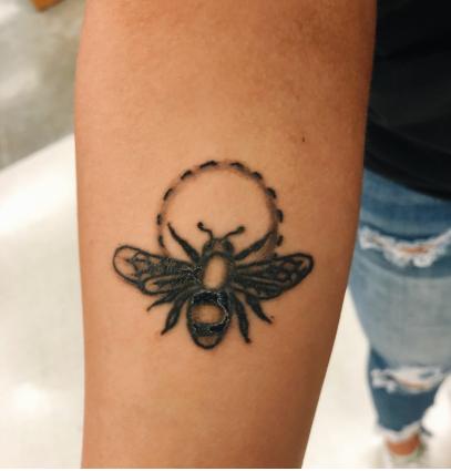 Senior, Kelsie Wilcox-Laurel, shows off her new bumble bee tattoo.