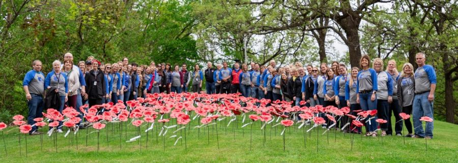 Teachers who helped create and place the poppies in the cemetery.