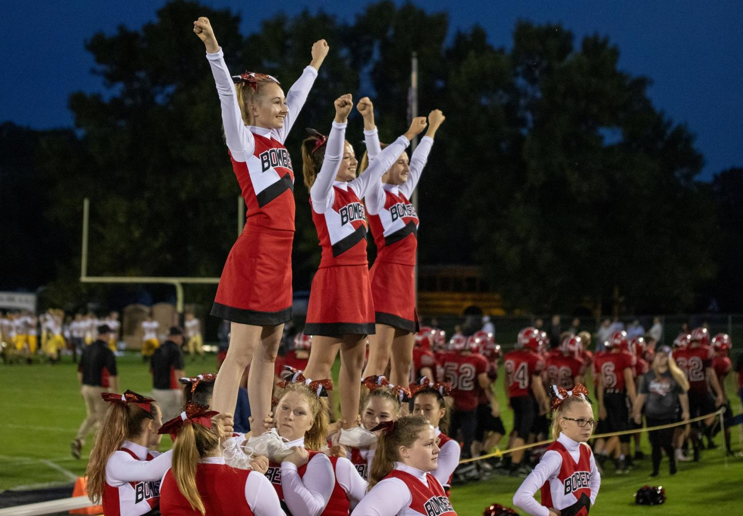 The cheer squad performing before fans at a recent home football game.